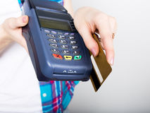 Girl holding a POS terminal, customer is paying by credit card. electronic money and credit card terminal stock image