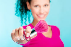 Girl holding powder brush, focus on brush Royalty Free Stock Images