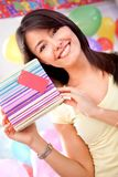 Girl holding a present Stock Photography