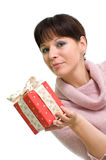 Girl holding present. Young brunette with red present isolated over white Stock Photo
