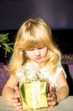 Girl holding present Stock Photo