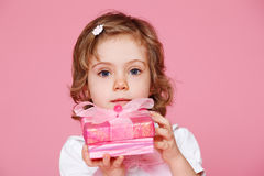 Girl holding present box Royalty Free Stock Image