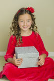 Girl Holding A Present for Christmas Stock Images