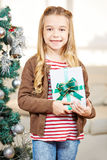 Girl holding present at christmas Royalty Free Stock Photo