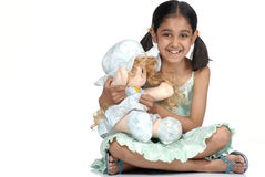 Girl holding pretty doll Royalty Free Stock Images