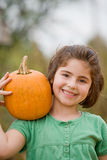 Girl Holding a Pumpkin Stock Images