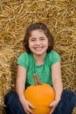 Girl Holding a Pumpkin Stock Image