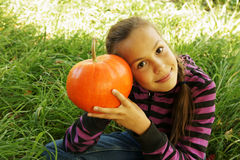 Girl holding pumpkin Royalty Free Stock Images