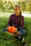 Girl holding pumpkin Royalty Free Stock Image