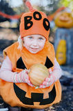 Girl holding pumpkin. Halloween concept Royalty Free Stock Images