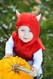 Girl holding pumpkin. Halloween concept Royalty Free Stock Photo