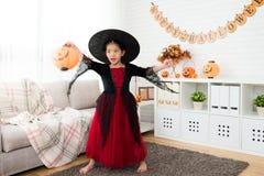 Girl holding pumpkin lantern play alone Royalty Free Stock Image