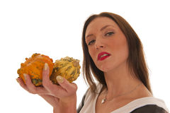 Girl holding pumpkins in hand Stock Image