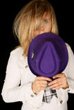 Girl holding purple hat with wild and crazy hair Royalty Free Stock Images
