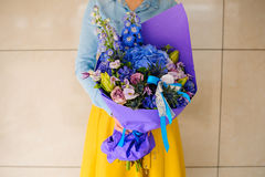 Girl holding purple and pink flower bouquet. No face Royalty Free Stock Photo