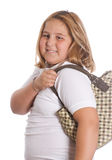 Girl Holding Purse. A young girl holding a purse over her shoulder, isolated against a white background Stock Photo