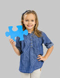 Girl holding a puzzle Stock Photo
