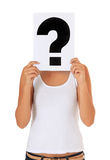 Girl holding question mark in front of her head Stock Photos