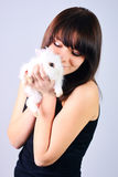 Girl holding a rabbit Royalty Free Stock Photos