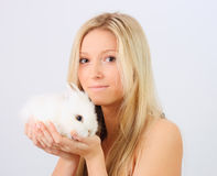 Girl holding a rabbit Royalty Free Stock Image