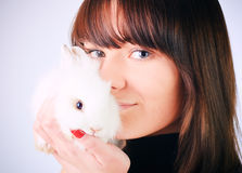Girl holding a rabbit Royalty Free Stock Photography