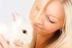 Girl holding a rabbit Stock Photo