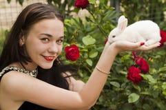 Girl holding rabbit Stock Photo