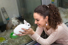 Girl holding the rabbit at pet shop Royalty Free Stock Photos