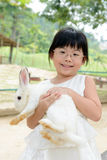Girl holding rabbit Royalty Free Stock Photo