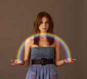 A girl holding a rainbow Royalty Free Stock Photos