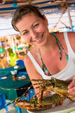 Girl holding a raw lobster Stock Photography