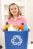 Girl Holding Recyling Waste Bin At Home. Smiling Stock Photography