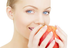 Girl holding a red apple isolated Stock Photography