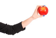Girl holding a red apple Royalty Free Stock Image
