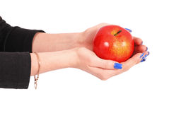 Girl holding a red apple Stock Images