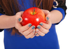 Girl holding a red apple Royalty Free Stock Photos