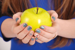 Girl holding a red apple Stock Photos