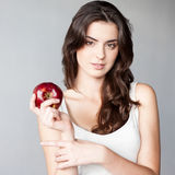 Girl holding red apple Stock Images