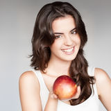 Girl holding red apple Stock Image
