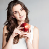 Girl holding red apple Royalty Free Stock Photo