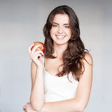 Girl holding red apple Royalty Free Stock Images