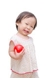 Girl holding red ball Stock Photo