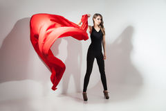 Girl holding red cloth waving Royalty Free Stock Photos