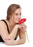 Girl holding a red flower Royalty Free Stock Images