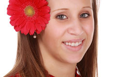 Girl holding a red flower Stock Photography