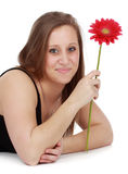 Girl holding a red flower Royalty Free Stock Image