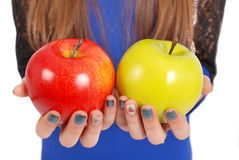 Girl holding a red and green apples Stock Photography