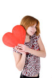 Girl holding red heart Royalty Free Stock Image