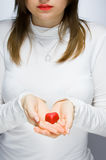Girl holding red heart. Focus on hands Stock Photo