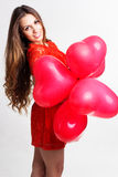 Girl holding red heart balloons, valentines day Stock Photos